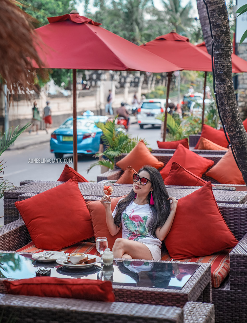 Girl having breakfast at Kuta Beach, Bali at Kuta Seaview Boutique Resort